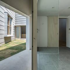 バスルーム: 武藤圭太郎建築設計事務所が手掛けた浴室です。