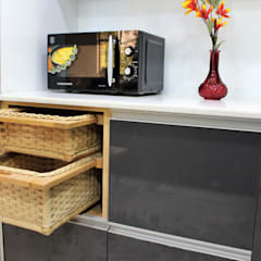 Added wicker baskets for utility and beauty:  Small kitchens by Easyhomz Interiors Pvt Ltd