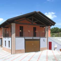 Casas de madeira  por Sangallo srl