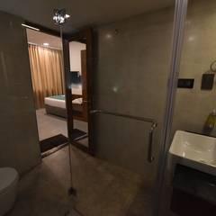 Vivid Hotel, Trichy:  Bathroom by Uncut Design Lab