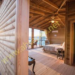 Casas prefabricadas de estilo  por SİSNELİ AHŞAP EV - AĞAÇ EV - KÜTÜK EV - BUNGALOV -KAMELYA