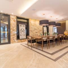 Dining room by C2HA Arquitetos, Rustic