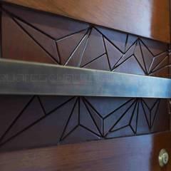 Origami house:  Doors by Squares design studio
