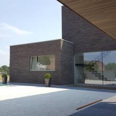 Façade entrée : Maison individuelle de style  par RIVA Architectes