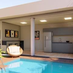 Área de relaxamento particular : Garagens e edículas  por Vortice Arquitetura