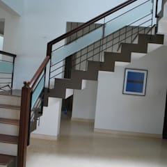 Divine Homes:  Stairs by Geometrixs Architects & Engineers