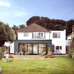The best home extension for modern home:  Detached home by STAAC