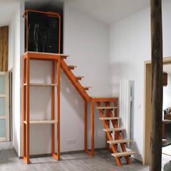 Escalier Mechanical Orange: Escalier de style  par Atelier Concret