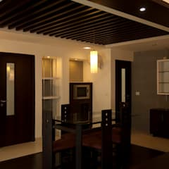 Dining room by S Squared Architects Pvt Ltd.