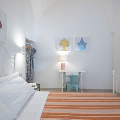 B&B I Colmi Trulli Suites: Camera da letto in stile  di ABBW angelobruno building workshop