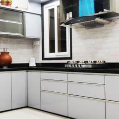 Brijdham (Bungalow):  Kitchen by Raj Creation