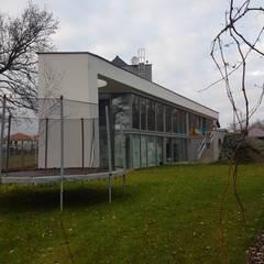 หลังคาลาด by Budownictwo i Architektura Marcin Sieradzki - BIAMS