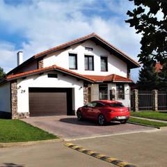 Casas unifamiliares de estilo  por студия  Александра Пономарева