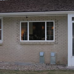 Brick Cutout and Window Installation:  Office buildings by 303 Windows