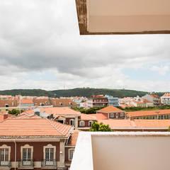 Apartamento Travessa dos Quartéis: Varandas  por Silva Cravo Arquitectos