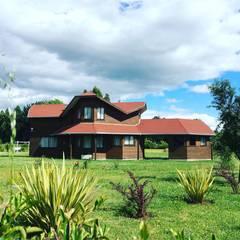 Vivienda V: Casas unifamiliares de estilo  por Nomade Arquitectura y Construcción spa