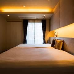 ベッドルーム: QUALIAが手掛けた寝室です。