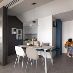 Dining room by 寓子設計,