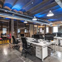 Oficinas NPAW: Edificios de oficinas de estilo  de ESTUDIO DE CREACIÓN JOSEP CANO, S.L.