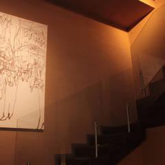 Muro de adobe.: Escaleras de estilo  por emARTquitectura