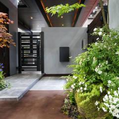 Pasillos y vestíbulos de estilo  por (有)ハートランド