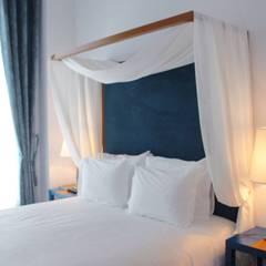 Hoteles de estilo  por MIA arquitetos
