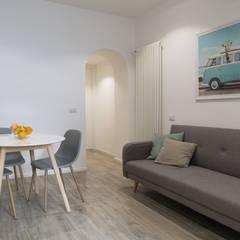 غرفة المعيشة تنفيذ studio ferlazzo natoli , إسكندينافي