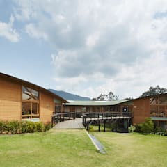 colegio Ekiraya: Escuelas de estilo  por CPM,
