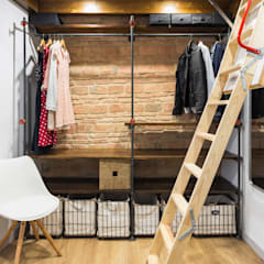 Dressing room by Arela Arquitectura, Rustic