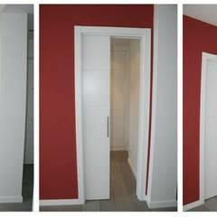 Reforma (remodelación) departamento.: Pasillos y recibidores de estilo  por Árbol Arquitectura