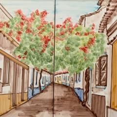 Rua Ferragudo: Paredes  por Arti Arte Azulejar