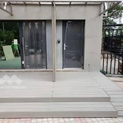 Casas multifamiliares de estilo  por 新綠境實業有限公司