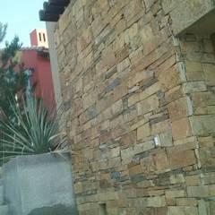 Multi-Family house by Trevalo Urbanizaciones y Construcciones, Rustic Stone