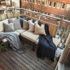 Balcón de estilo  por homify