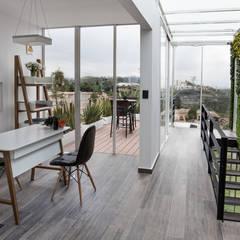 22. OFICINAS GRUPO LAR: Oficinas y tiendas de estilo  por TARE arquitectos