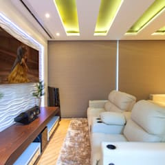 Casa Vanessa: Salas multimídia  por Designer de Interiores e Paisagista Iara Kílaris