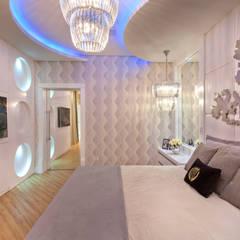 Casa Vanessa: Quartos  por Designer de Interiores e Paisagista Iara Kílaris