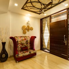 Residence Mr. Hardeep:  Corridor & hallway by Studio Ezube