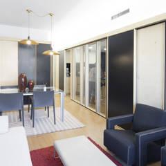 Reforma de un piso de 85m2 en Barcelona: Comedores de estilo  de AlbertBrito Arquitectura