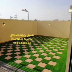 Cobertizos de estilo  por شركة تنسيق حدائق عشب صناعي عشب جداري 0553268634