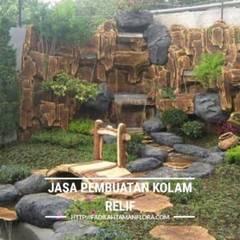 Pembuatan Taman Kolam Relief Air Terjun: Taman oleh Berkah indah taman, Minimalis Batu Tulis