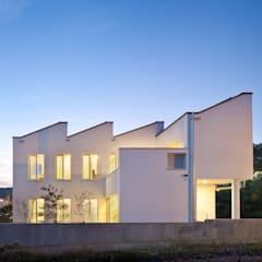 Country house by 건축사사무소 모뉴멘타