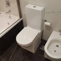 Baños modernos de homify Moderno Mármol