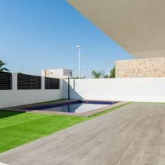 Vivienda unifamiliar en la Eliana: Jardines de estilo  de Esther Vidal. Arquitectura, paisaje y diseño