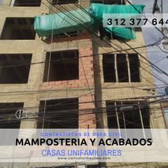 MAMPOSTERIA Y ACABADOS: Conjunto residencial de estilo  por CARLOS HORMECHEA ARQUITECTURA