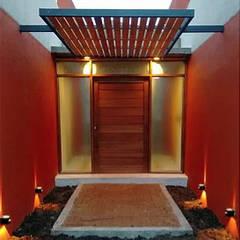 Front doors by 1.61 Arquitectos