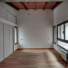 """Diseño y construcción de Casa """"patios entre medianeras"""" por 1.61 Arquitectos: Dormitorios de estilo  por 1.61 Arquitectos"""