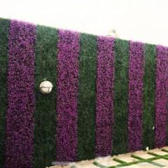 Jardines en la fachada de estilo  por تنسيق الحدائق ,