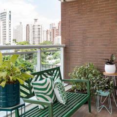 apartamento pequeno e integrado: Terraços  por estudio AMF arquitetura