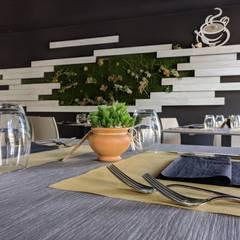 Settemila Special - ristorante: Negozi & Locali commerciali in stile  di Studio Tecnico Trovato